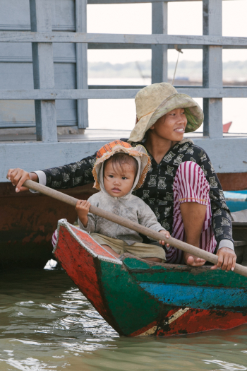 Woman and Child Boat Cambodia