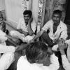 Men Sitting in the Streets of Delhi