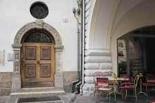 Wood Door and Cafe Seating in Bolzano Italy