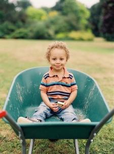 Young Boy in Wheelbarrow in Norfolk England