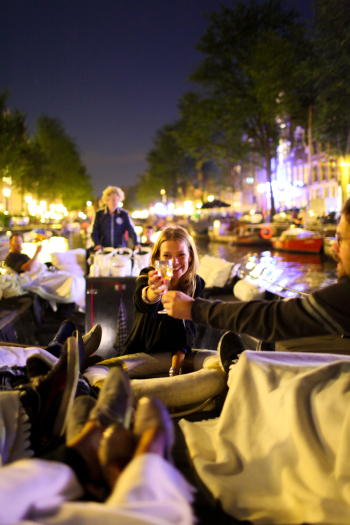 Toasting at the Canal in Amsterdam