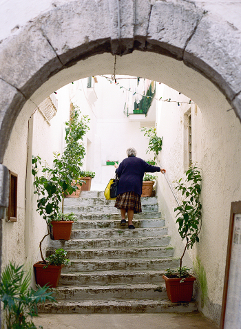 Woman Climbing Stairs on the Amalfi Coast