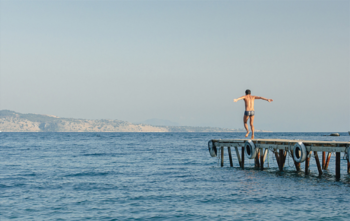 Man on the Pier at Agni Beach in Corfu Greece