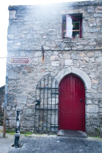 Red Door and Stone Building in Connemara Ireland