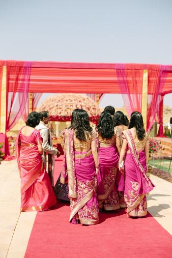 Girls Walk to Pheras Ceremony at Suryagarh Palace in India