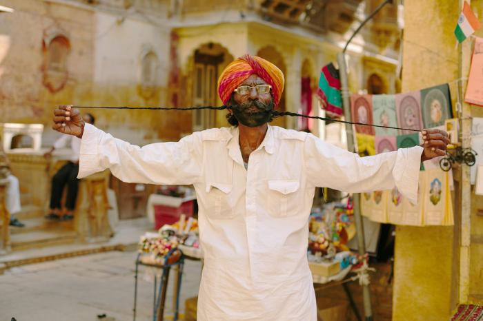 Man Plays with Facial Hair in Jaisalmer India