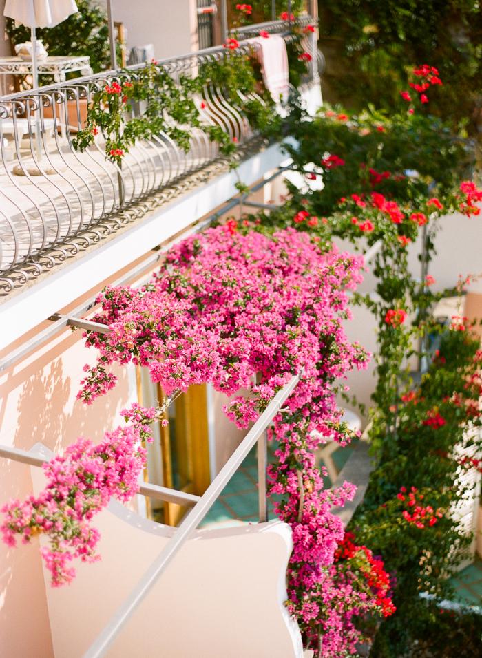 pink balcony flowers in positano italy entouriste