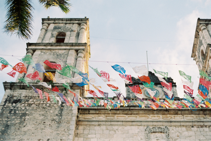 Church and Colorful Flags in Playa del Carmen Mexico
